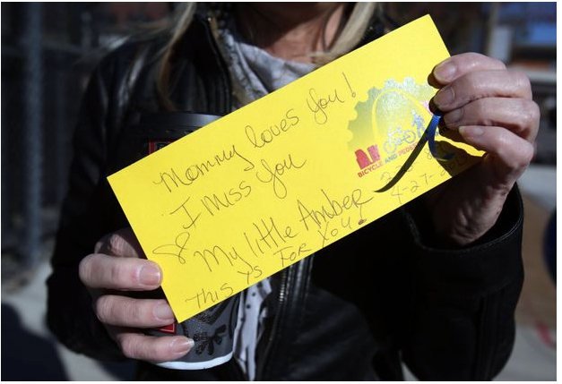 "Georgie Busch shows the message she wrote to attach to a balloon she released in honor of her daughter Amber Wood on Sunday, Nov. 15, 2015, at a vigil for World Day of Remembrance for Road Traffic Victims. Wood was struck and killed on April 27, 2012, in the 700 block of South Broadway south of Busch Stadium. Another pedestrian, Ashish ""Bapi"" Gupta, was struck nearby on June 28, 2015. Their deaths prompted a group of friends and family to push for a new crosswalk and other road improvements in the area. The new crosswalk has now been put in place. Photo by Laurie Skrivan, lskrivan@post-dispatch.com"